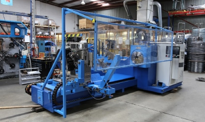 Positioning coil machine to maximise space and workflow